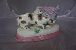 A continental porcelain ornament with a vase, having a spaniel chasing a rabbit