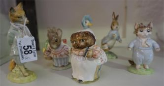 Eight assorted Beatrix potter figures to include examples by Royal Albert, Beswick and Royal Doulton