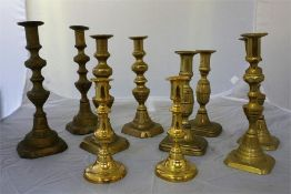 Five pairs of brass candle sticks