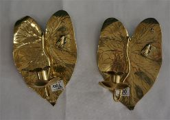 A pair of Arts and Crafts brass wall candle sconces, with leaf design, back plated with raised