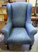 A Late 19th Century Upholstered Wing Armchair