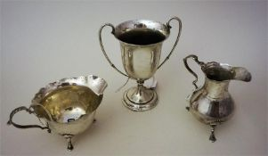 Two Silver Cream Jugs And a Silver Cup