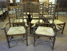 A Set Of Twelve Lancashire Style Spindle Back Dining Chairs