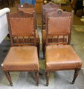 A Set Of Four Edwardian Oak Dining Chairs