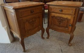 A Pair Of French Oak Bedside Cabinets