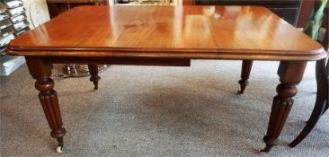 A Victorian Mahogany Wind Out Dining Table