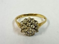 A Ladies Diamond 9ct Gold Cluster Ring, ring size O
