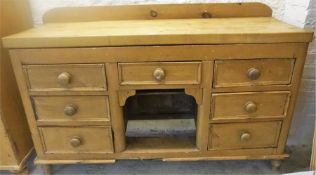 A Victorian Pine Dresser Base, with associated plank top above fitted drawers and open recess,