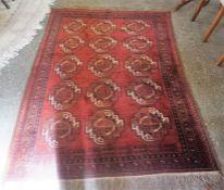 A Hamadan Machine Made Rug, Decorated with five rows of three Geometric medallions on a red