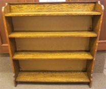 An Oak Bookcase, with open shelving, 103cm high, 100cm wide