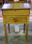 A Pine Farmhouse Clerks Desk, in two sections, the detachable top with gallery above a hinged