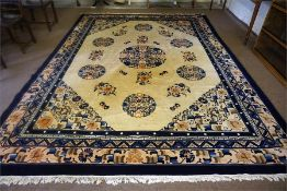 A Large Chinese Carpet, Decorated with floral panels and geometric motifs, on a cream ground with