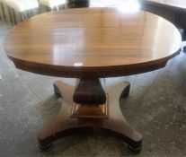 A William IV Rosewood Centre Table, the circular top raised on a faceted column and platform base,