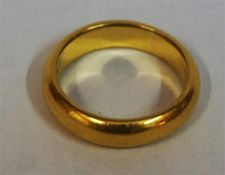 A 22ct Yellow Gold Wedding Band, size N, 8.6 grams