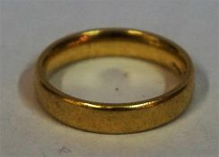 An 18ct Yellow Gold Wedding Band, size N, 5.1 grams
