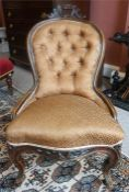 A Victorian Mahogany Framed Ladies Parlour Chair, Upholstered in later dralon, raised on shaped legs