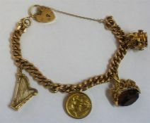 A 9ct Gold Charm Bracelet, with assorted charms, to include a Gold 1902 half sovereign, overall
