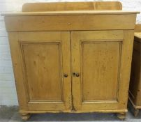 A Victorian Pine Farmhouse Kitchen Cupboard, with two panelled doors enclosing a shelved interior,