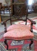 An Edwardian Mahogany Ladies Parlour Armchair, with pink upholstered stuff over serpentine seat,