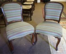A Pair Of Victorian French Walnut Dining Chairs, upholstered in later fabric, with stuffover seat,