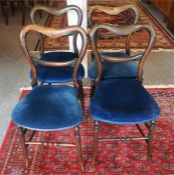 A Set Of Four Late Victorian Rosewood Parlour Chairs, with later blue velour stuff over seats,