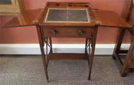 An Edwardian Mahogany Ladies Desk, with two hinged divisions enclosing an adjustable writing