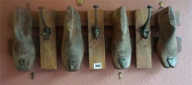 A French Wooden Wall Mounting Hat & Coat Rack, in the form of four Dutch carved wood clogs, with