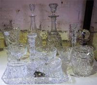 A Quantity Of Crystal Wares, to include a silver necked decanter, decanters, vases and glasses, also
