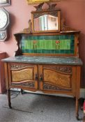 A Late Victorian Glasgow Style Walnut Wash Stand, with mirrored top above Art Nouveau turquoise