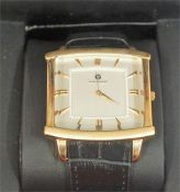A Gents Wristwatch By Enzo Giomani, with gilt metal Arabic baton numerals on a silvered dial, on a