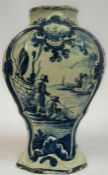 An 18th Century Delft Pottery Vase, of octagonal baluster form, in typical colours, decorated with a