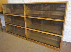 A Vintage Stacking Bookcase By Simplex, having six sections, each section with glazed sliding doors,