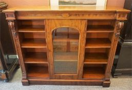 A Victorian Mahogany Open Bookcase, circa 1870, of low form, with a central glazed door enclosing
