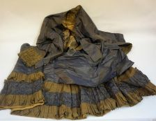 A Victorian Silk Ladies Jacket With Matching Skirt, in blue with beige cuffs and trim, jacket 51cm