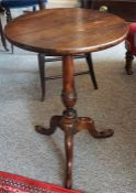 A 19th Century Mahogany Tripod Table, the circular top raised on turned column and tripod base, 63cm