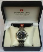 A Gents Wristwatch By Swiss Balance, with rotating bezel, Arabic numerals on a blue dial, on a