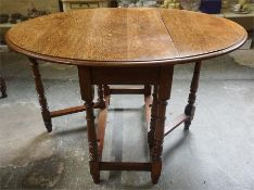 An Oak Gateleg Table, with D ends, raised on turned legs, 72cm high, 92cm long, 120cm wide