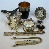 A Mixed Lot Of Silver Items, to include three assorted silver pepper pots, a Scottish silver