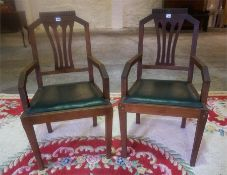 A Pair Of Oak Carver Armchairs, with shaped rail back, detachable seat, with label to reverse for