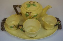 A Carlton Ware Australian Design Tea For One Set, comprising of tea pot, cup, cream and sugar on
