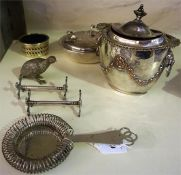 A Small Quantity Of Silver Plated Wares, to include a strainer, pair of knife rests, sucrier, bowl