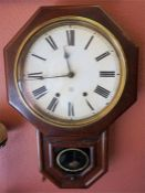 A Victorian American Mahogany Eight Day Wall Clock, in octagonal frame, with pendulum, 62cm high