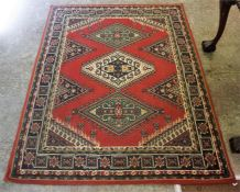 A Kashmir Machine Made Rug, Decorated with three Geometric panels to the centre, with a floral