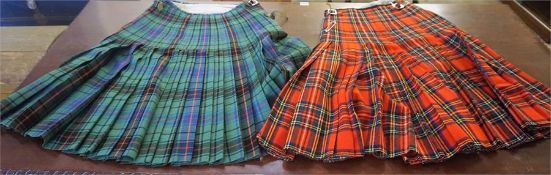 Two Dress Kilts, one sized for a 30-32 inch waist, the other in the clan Stewart tartan, 28 inch