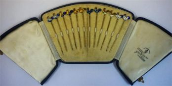 A Set Of Twelve Sterling Silver & Enamel Cocktail Sticks, Decorated with enamel cockerel surmount,