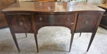 A George VI Mahogany Inlaid Serpentine Sideboard, with a central drawer, flanked by a cellarette