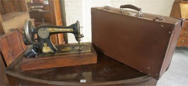 A Vintage Singer Table Sewing Machine, also with a vintage suitcase, (2)