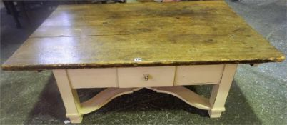 A Large Farmhouse Coffee Table, with a wood plank top above a white painted base with single drawer,