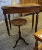 A Victorian Walnut Folding Card Table, a/f to interior, raised on reeded and turned tapered legs,