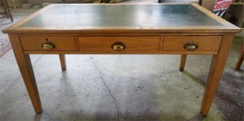 An Edwardian Ash Writing Table, with a green skiver to the top above three drawers, raised on